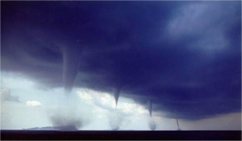 Waterspout line over a body of water