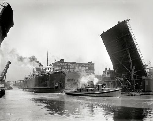 "1910 | The Chicago River . ""Pere Marquette transfer boat 18 passing State Street bridge"""