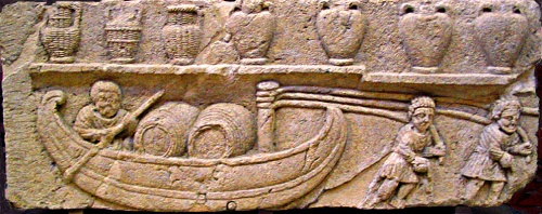 Gallo-Roman relief depicting a river boat transporting wine barrels, an invention of the Gauls that came into widespread use during the 2nd century; above, wine is stored in the traditional amphorae, some covered in wicker