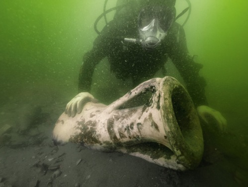 "Working in water Photograph by Teddy Seguin and Lionel Roux - rarely this clear—""we were groping around in a labyrinth,"" says archaeologist Sabrina Marlier—divers brought up thousands of clay jars known as amphorae. This Spanish one carried fish sauce."