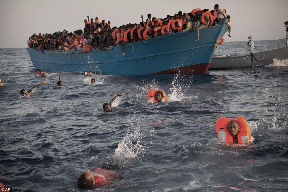 37ADE67800000578-4196010-Migrants_most_of_them_from_Eritrea_jump_into_the_water_from_a_cr-a-75_1486386810739